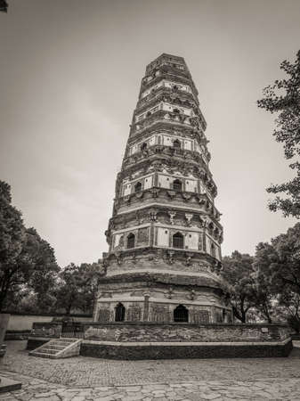 chinese pagoda: Tiger Hill Pagoda (Yunyan Pagoda) on the Tiger Hill in Suzhou city, Jiangsu Province of Eastern China. It is nicknamed the Leaning Tower of China. Black and white photography.