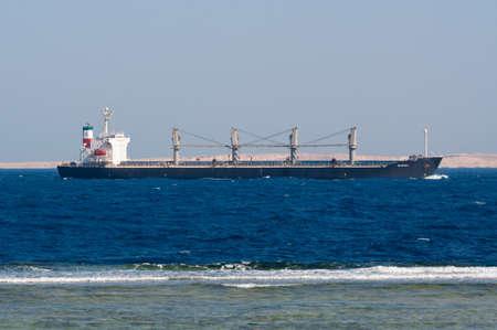 el sheikh: Sharm El Sheikh, Egypt - November 21, 2010: Bulk Carrier Valopoula sails along the shore of the Red Sea near Sharm El Sheikh, Egypt at November 21, 2010. Type of vessel: Bulk Carrier. Flag: Bahamas.