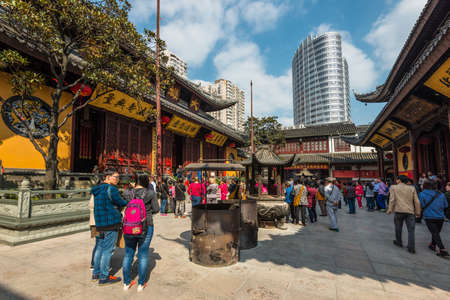 jade buddha temple: Shanghai, China - October 26, 2013: People visit the Jade Buddha Temple (founded 1882) in Shanghai, China. Buddhism is enjoying a revival in modern liberal China. Editorial
