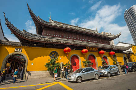 wideangle: Shanghai, China - October 26, 2013: A wide-angle view of the Jade Buddha Temple exterior (founded 1882) in Shanghai, China. Buddhism is enjoying a revival in modern liberal China. Editorial