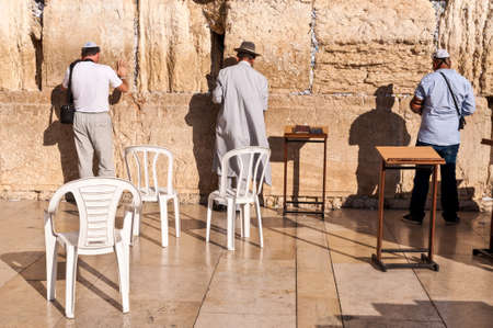 hasidism: Jerusalem, Israel - November 19, 2010: Jewish men praying at the wailing wall at November 19, 2010, in Jerusalem, Israel