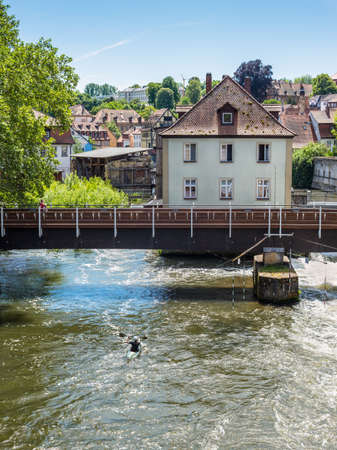 Bamberg, Germany - May 22, 2016: Canoeist on the River Regnitz against the background of the bridge, and the architecture of the old town of Bamberg, Bavaria, Germany, Europe. Editorial