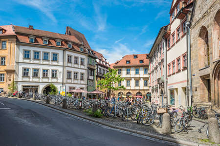 Bamberg, Germany - May 22, 2016: Pubic bicycle parking station with countless bikes standing lined up in the UNESCO world heritage town Bamberg, Germany .