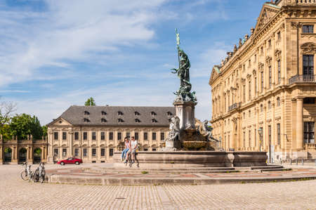 residenz: Wurzburg, Germany - May 22, 2016: Wurzburg Residence palace and statue Frankonia fountain in the foreground at Wurzburg, Bavaria, Germany. Editorial