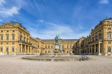 residenz: Wurzburg, Germany - May 22, 2016: Wurzburg Residence palace and statue Frankonia fountain in the foreground at Wurzburg, Germany.