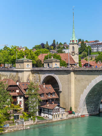 Bern, Switzerland - May 26, 2016: Medieval houses lining the banks of the Aare river in Bern (Unesco Heritage), the capital of Switzerland Editorial