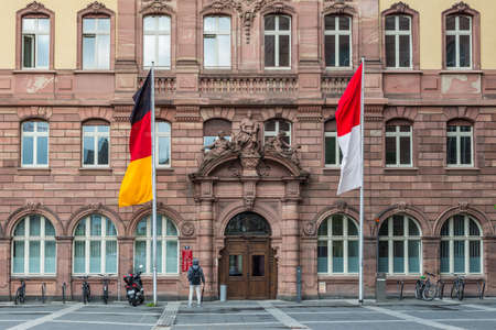 encircling: Frankfurt am Main, Germany - May 23, 2016: Detail of the Old Town Hall on the Paulsplatz square in Frankfurt am Main, Germany. The entire building complex consists of nine houses, encircling six courtyards.