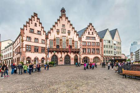 roemerberg: Frankfurt am Main, Germany - May 23, 2016: Tourists on the Romerberg Square on a cloudy rainy weather in Frankfurt am Main, Germany, Hesse, Germany. Editorial