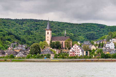 belongs: Lorch, Germany - May 23, 2016: Coast in the Lorch am Rhein in cloudy weather, a small town in the Rheingau-Taunus-Kreis in Germany. It belongs to the Rhine Gorge World Heritage Site. Editorial