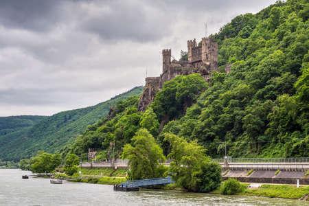 rudesheim: Trechtingshausen, Germany - May 23, 2016: Rheinstein Castle  in cloudy weather on the Rhine Gorge near Trechtingshausen, Rhine Valley, Rhineland-Palatinate, Germany.