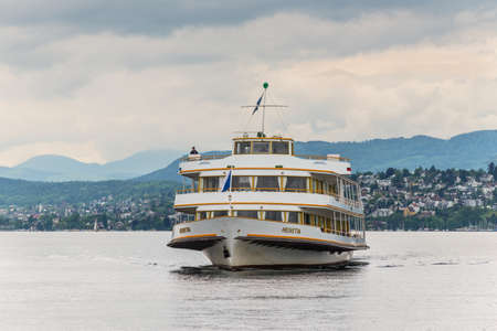 Zurich, Switzerland - May 24, 2016: MS Helvetia vessel on Lake Zurich approaching the city of Zurich, Switzerland. The name Helvetia expresses the female national personification of Switzerland. Editorial
