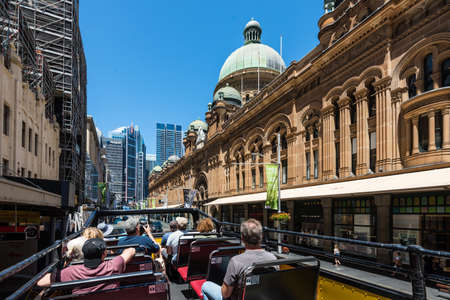 sydney australia: Sydney, Australia - November 8, 2014: Hop-on Hop-off buses are a great way to visit and explore the sights in Sydney. People can get on and off the bus at designated locations throughout the city to see sights around the city. These double decker buses ar