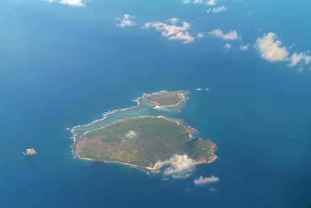 governed: Aerial view of the Flat Island and Gabriel Island, islands in the Indian Ocean, governed by Mauritius. Pigeon House Rock is seen on the left.