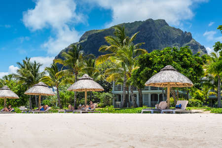 Le Morne, Mauritius - December 7, 2015: A sunny day on the Le Morne Brabant tropical beach, one of the finest beaches in Mauritius and the site of many tourism facilities. Editorial