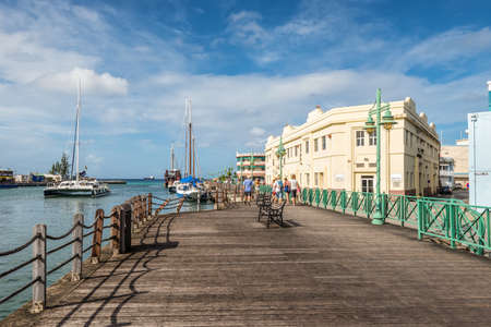 Bridgetown, Barbados - December 18, 2016: Wooden quay of downtown at the Port of Bridgetown, Barbados. Historic Bridgetown and its Garrison is a World Heritage Site of UNESCO.