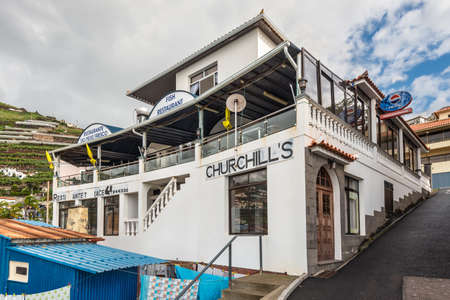 churchill: Camara de Lobos, Madeira, Portugal - December 10, 2016: Winston Churchill was a fan of Madeira and spent time in Camara de Lobos. This fish restaurant is named after him. Editorial