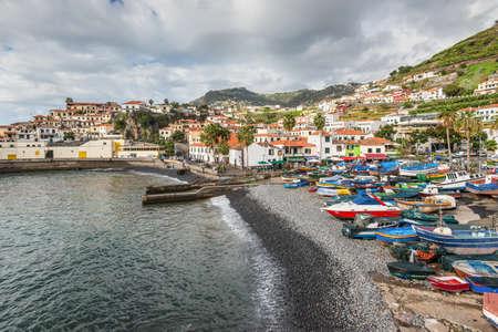 churchill: Camara de Lobos, Madeira, Portugal - December 10, 2016: Camara de Lobos near Funchal, Madeira Island in cloudy weather. In this fishing village Winston Churchill spent much time for paining.