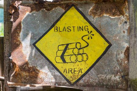 blasting: Blasting area warning sign, old and rusty
