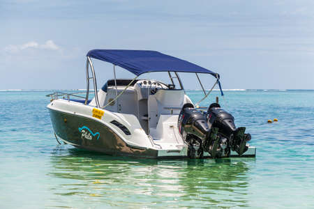 Le Morne, Mauritius - December 7, 2015: A sunny day with speed boat on the Le Morne Beach, one of the finest beaches in Mauritius and the site of many tourism facilities.