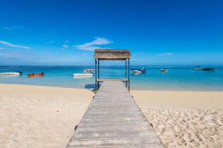 Le Morne, Mauritius - December 11, 2015: Beautiful gazebo on the tropical white sandy beach in the Le Morne Bay, Mauritius.