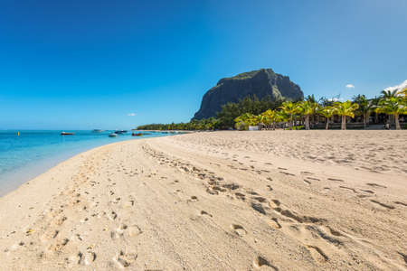 Le Morne, Mauritius - December 11, 2015: A wide-angle view on the Le Morne Beach, one of the finest beaches in Mauritius. Le Morne Brabant mountain in the background.