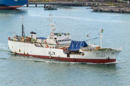 Port Louis, Mauritius - December 12, 2015: Large Fishing Vessel DONG WON NO.117 sailing at Port Louis, Mauritius. Port Louis was already in use as a harbor in1638.