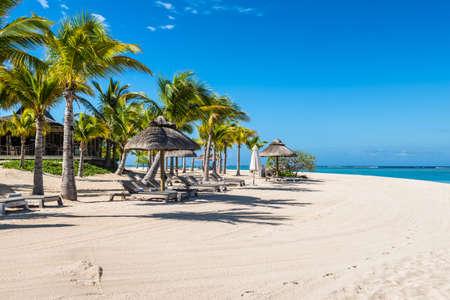 Le Morne, Mauritius - December 11, 2015: Amazing white beaches of Mauritius island. Tropical vacation in Le Morne Beach, Mauritius.