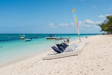 Le Morne, Mauritius - December 11, 2015: Leisure time possibilities, pedal boats, catamarans on the Le Morne Beach, one of the finest beaches in Mauritius and the site of many tourism facilities.