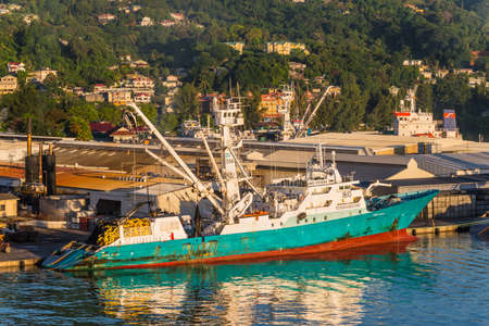 ship bow: Victoria, Mahe island, Seychelles - December 15, 2015: Modern industrial fishing vessel TORRE GIULIA in the morning sun in the harbor of Port Victoria, Mahe island, Seychelles.
