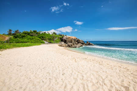 Sunny day on Anse Nord DEst beach in the north of Mahe Island, Seychelles