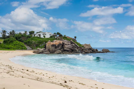 Sunny day on a wild and beautiful Anse Nord DEst beach in the north of Mahe Island, Seychelles. Stock Photo
