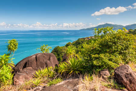 northwest: View from Anse Major Trail over the northwest coastline of Mahe island and granite rock in the foreground