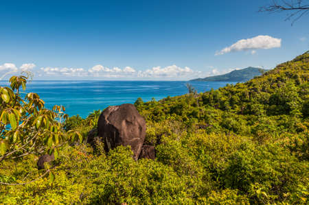 oceanic: View from Anse Major Nature Trail over the northwest coastline of Mahe island and granite rock in the foreground, Seychelles