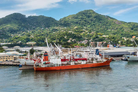 Victoria, Mahe island, Seychelles - December 17, 2015: Reefer ship Retriever in import export and business logistic at the harbor of Port Victoria, Mahe island, Seychelles, Indian Ocean, East Africa.
