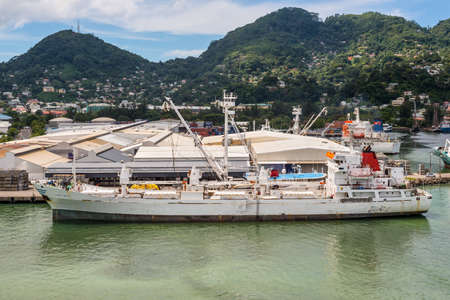 Victoria, Mahe island, Seychelles - December 17, 2015: Reefer ship Platte Reefer in import export and business logistic at the harbor of Port Victoria, Mahe island, Seychelles, Indian Ocean, East Africa.