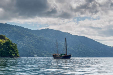 cloudscapes: Hell-Ville, Madagascar - December 19, 2015: SV Ooskus vessel anchored at Andavakotakona Bay, near Hell-Ville, Nosy Be Island, Madagascar. S.V. OOSKUS - unique 100ft expedition vessel - built to withstand the rigours of the southern oceans.
