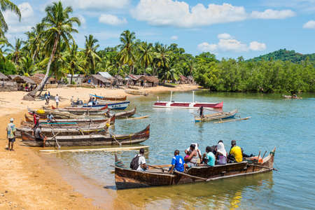 Ambatozavavy, Nosy Be, Madagascar - December 19, 2015: Traditional wood pirogue with outrigger waiting for passengers in the fishing Ambatozavavy village on the Nosy Be island, Madagascar. Editorial