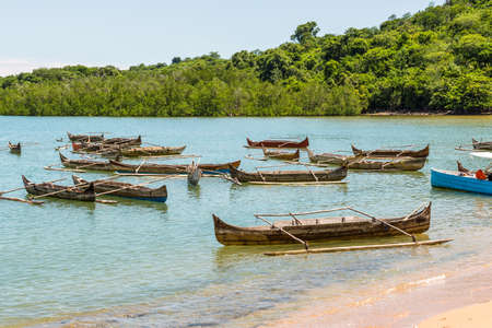 Traditional wooden dugout rowing outrigger canoes on Nosy Be island, Madagascar