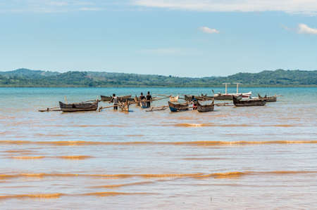 Ampasipohy, Nosy Be, Madagascar - December 19, 2015: Aboriginal traditional Malagasy pirogue - wooden outrigger canoes (carved from a tree trunk) at Nosy Be Island, Madagascar. Editorial