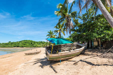 Wooden boat on the beach in a fishing village on Nosy Be island, Madagascar, Africa Stock Photo