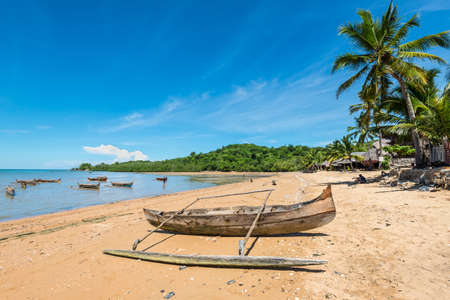 Ampasipohy, Nosy Be, Madagascar - December 19, 2015: Traditional pirogue on the shore of Nosy Be island in Madagascar, Africa.