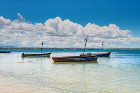steadily: Ramena, Madagascar - December 20, 2015: Traditional Malagasy wooden fishing sail boats on the sea coast, Madagascar. Ramena is a charming, steadily growing fishing village located in Diego Suarez Bay.