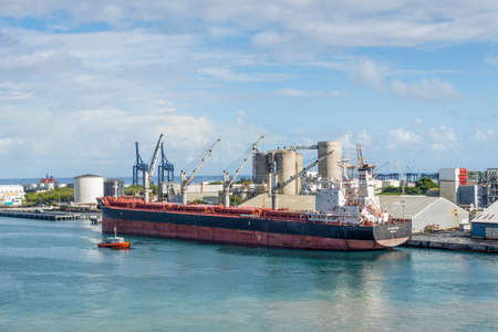 Port Louis, Mauritius - December 25, 2015: Bulk Carrier Ship JS Colorado in Port Louis, Mauritius. Port Louis was already in use as a harbor in 1638.