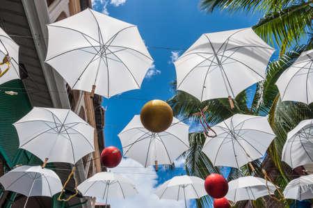 Port Louis, Mauritius - December 25, 2015: Umbrella art display in street at Caudan Waterfront, Port Louis, Mauritius.