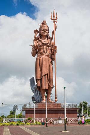 Grand Bassin, Mauritius - December 26, 2017: Mangal Mahadev - Shiva Statue, 33 m tall Hindu god, standing at the entrance of Ganga Talao - Grand Bassin lake the most sacred Hindu place on Mauritius. Editorial