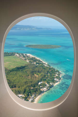 Mauritius Island aerial view through aircraft windows