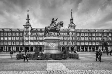 Madrid, Spain - May 22, 2014: Plaza Mayor with statue of King Philips III in Madrid, Spain. Black and white retro style. Architecture and landmark of Madrid. Editorial
