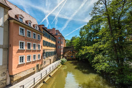 the little venice: Bamberg, Germany - May 22, 2016: The Ludwig Canal in historic medieval city of Bamberg, Germany. Cascade of styles, from Gothic and Baroque to late Romanticism, form the architecture of the old imperial and archbishopric city. Bamberg is under UNESCO prot Editorial