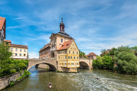 Bamberg, Germany - May 22, 2016: Scenic spring wide-angle view of the Old Town architecture with City Hall building in Bamberg, Germany.