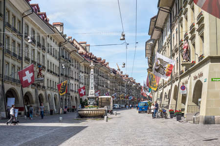 Bern, Switzerland - May 26, 2016: Street view on Kramgasse with fountain in the old town of Bern city. It is a popular shopping street and medieval city centre of Bern, Switzerland. Editorial